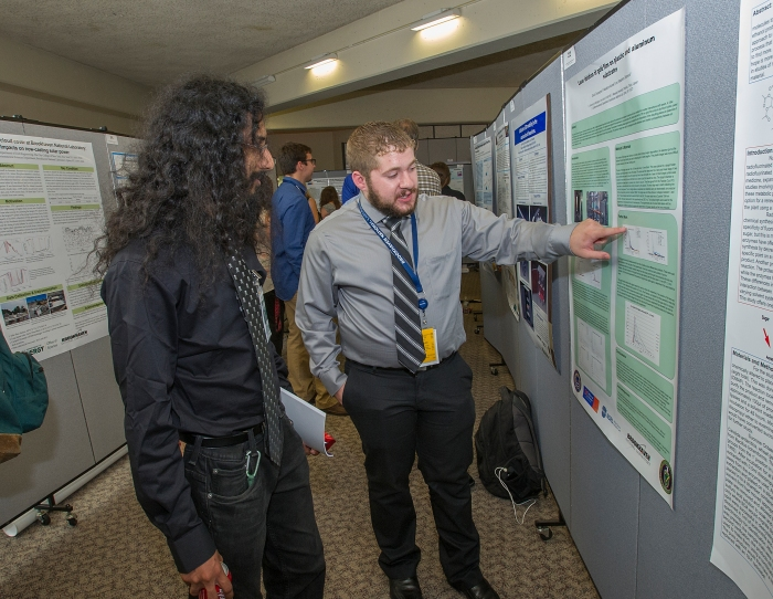 Summer Undergraduate Research Internship (SULI) participant David Cinquegrani shares his research on Brookhaven's Laser Ion Source (LION), which feeds into the Lab's atom smashing Relativistic Heavy Ion Collider (RHIC), with fellow intern Rajeev Seemungal.
