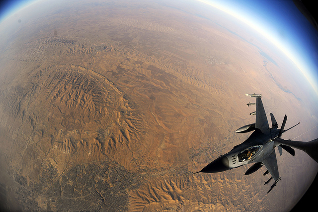 A U.S. Air Force F-16 Fighting Falcon refueling over Iraq in 2010. The plane can fly at altitudes of more than 50,000 feet, high enough to put pilots at increased risk for brain lesions. [Image credit: Flickr user U.S. Air Force]