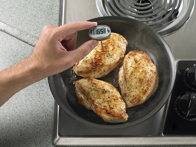 Using a meat thermometer to ensure your meal is fully cooked can prevent bacteria such as salmonella from making you sick. More than 1 million people get salmonella from contaminated chicken every year: 19,000 have to go to the hospital, and 380 die. [Image credit: Flickr user U.S. Department of Agriculture ]