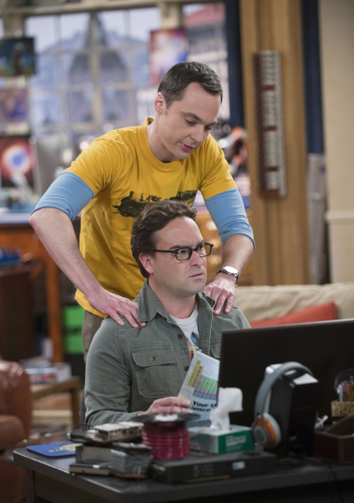 """The Leftover Thermalization"" -- Friction ensues when a magazine fails to mention Leonard (Johnny Galecki, seated) in an article about the paper he co-wrote with Sheldon (Jim Parsons, standing), on THE BIG BANG THEORY, Thursday, March 12 (8:00-8:30 PM, ET/PT), on the CBS Television Network.  Photo: Neil Jacobs/CBS ©2015 CBS Broadcasting, Inc. All Rights Reserved"